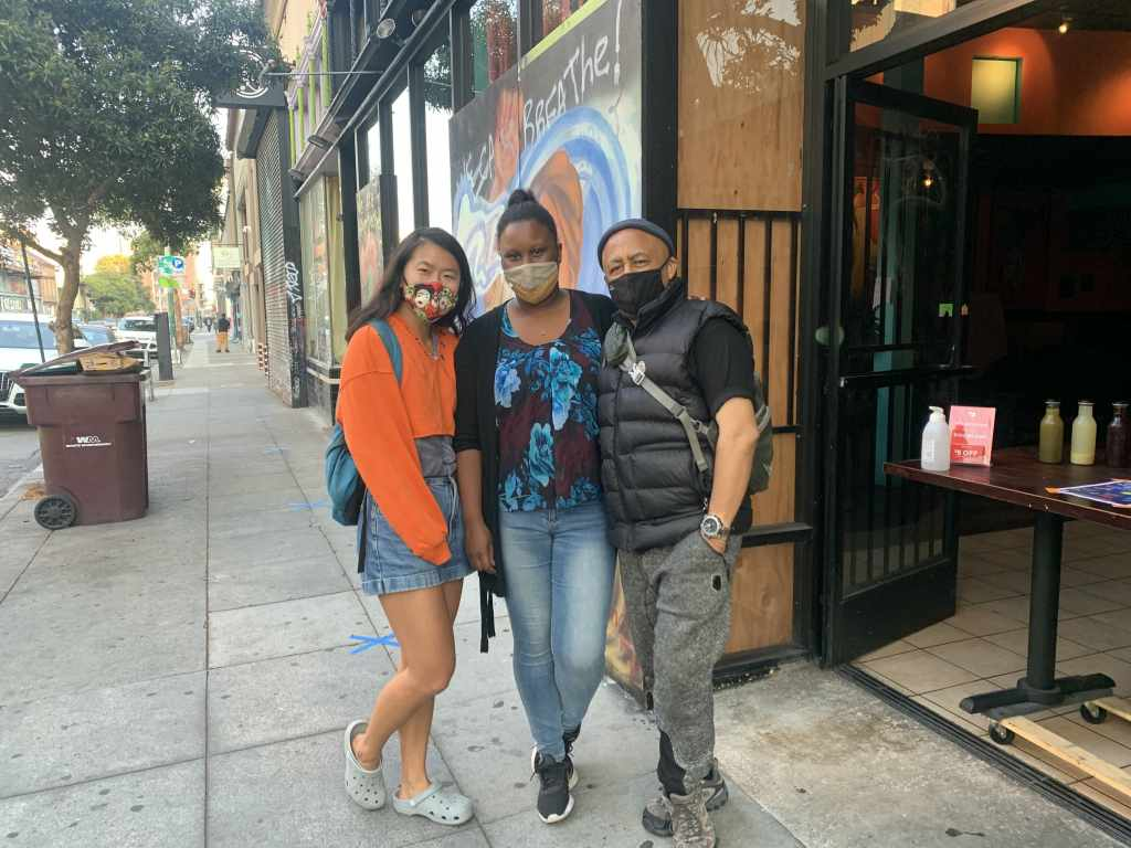 Right to left: Marco Senghor, Marina Houngbadji, and Yichen Feng outside Bissap Baobab in Oakland. Credit: Ricky Rodas