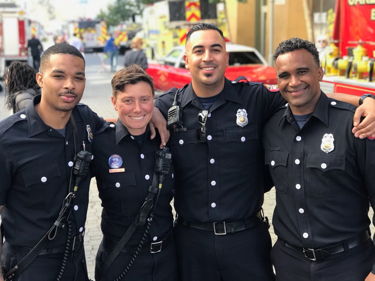 (From Left to Right) Devin Brown, Cassandra Kays, Gustavo Gonzalez, Micheal Andrews of the Oakland Fire Department, all smiles during pre-pandemic times.