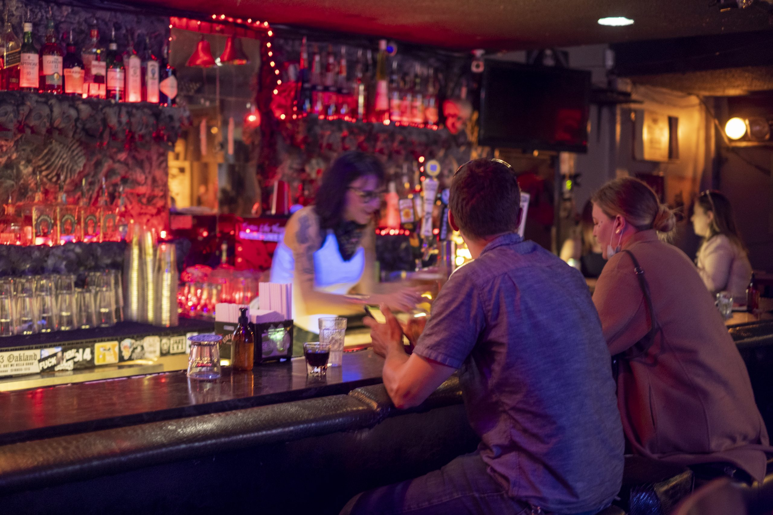 We're back to being people': The first night without masks at Oakland's bars